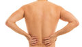 Man holds his back due to pain is touching because it aches Stock Images