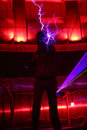 Man holds lightning at presentation of attraction moscow february megavolt master vvc on february in moscow russia Stock Photo