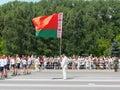 Man holds national flag of Belarus
