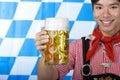 Man holds Oktoberfest beer stein (Mass) Stock Photos