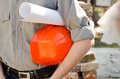 Man holds a protective construction helmet Royalty Free Stock Photo