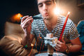 Man holds red-hot coal with tongs, hookah smoking Royalty Free Stock Photo