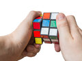 Man holds rubiks cube in hands. June 11th 2016, Czech Republic. Royalty Free Stock Photo