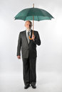 A man holds an umbrella Stock Photos