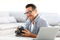 Man at home using camera Royalty Free Stock Photo