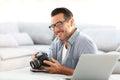 Man at home using camera Royalty Free Stock Photo