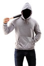 Man in a hoodie holding a baseball bat symbolizing crime isolated on white background Stock Photography