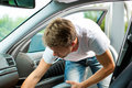 Man is hoovering or cleaning the car Royalty Free Stock Photo