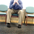 Man in hospital waiting room grieving with sorrow and sadness Royalty Free Stock Photography