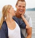 Man hugging his girlfriend, outdoors Royalty Free Stock Images