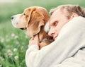 Man hugs his favorite dog Royalty Free Stock Images