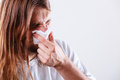 Man with hygienic tissue allergy and cold concept young long haired sick guy blowing nose Royalty Free Stock Photo