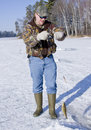 Man ice fishing Royalty Free Stock Photo