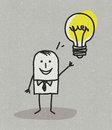 Man with idea and light bulb hand drawn cartoon characters on textured background Royalty Free Stock Image