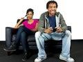 Man ignoring girlfriend while playing video games