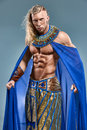 The man in the image of ancient egyptian pharaoh on blue background Royalty Free Stock Photo
