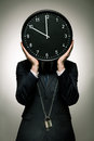 Man imprisoned by passing time elegant in suit big clock instead of s head Royalty Free Stock Photography