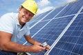 Man installing solar panels Royalty Free Stock Photo