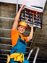 Man installing suspended ceiling in builder uniform Royalty Free Stock Images