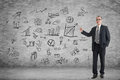 Man introduce plan asian business on the wall in a room Royalty Free Stock Photos