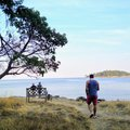 Man on an island by the shore thinking and contemplating Royalty Free Stock Photo