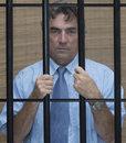 Man in jail businessman behind bars Royalty Free Stock Photos