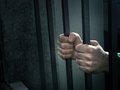 Man in jail hands close up depression and despair concept Royalty Free Stock Photo
