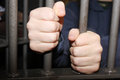 Man in jail trying to reach out Royalty Free Stock Photography