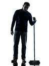 Man janitor brooming cleaner boredom silhouette full length one caucasian in studio isolated on white background Royalty Free Stock Photo