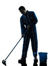 Man janitor cleaner cleaning silhouette one caucasian in studio on white background Royalty Free Stock Photos