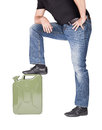 Man with jerrycan a foot on isolated on white Royalty Free Stock Images