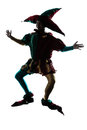 Man in jester costume silhouette jumping Royalty Free Stock Photo