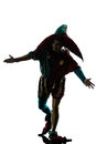 Man in jester costume silhouette saluting Stock Photo