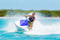 Man on jet ski having fun in ocean Stock Photos