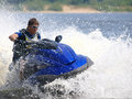 Man on jet-ski turns very fast Royalty Free Stock Photo
