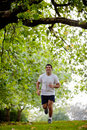 Man jogging outdoors Stock Image