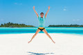 Man Jump On Beach With Two Isl...