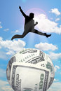 Man jump over money silhouette businessman sphere Stock Photos