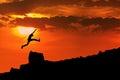 Man jump through the rock Royalty Free Stock Photo