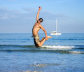 Man jumping on beach happy young the above water Royalty Free Stock Photo