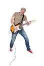 Man jumping with electric guitar in the air, isolated on white Royalty Free Stock Photo
