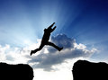 Man jumping a gap in sky Royalty Free Stock Photos