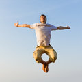 Man jumping happy young against blue sky at sunset Stock Images