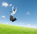 Man jumping on  meadow Royalty Free Stock Photo