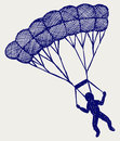 Man jumping with parachute Royalty Free Stock Photo