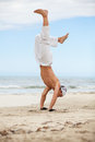 Man is jumping sport karate martial arts fight kick jump beach summertime Stock Photography