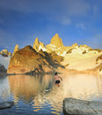 Man jumping to cold lake under Fitz Roy mountain Royalty Free Stock Photo