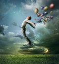 Man jumping up to Sky wit color bright balloon Royalty Free Stock Photo