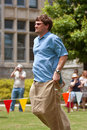 Man jumps along in sack race at spring festival atlanta ga usa may an unidentified competes a the great a celebrating great Royalty Free Stock Photography