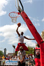 Man jumps over person to perform slam dunk in contest athens ga usa august a young someone a basketball the competition of a on Stock Photo